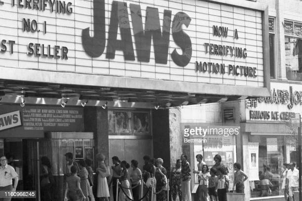 """Crowds line up outside movie house to see """"JAWS."""""""
