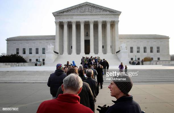 Crowds line up outside the US Supreme Court to attend the day's session on December 4 2017 in Washington DC The Supreme Court is scheduled to hear...