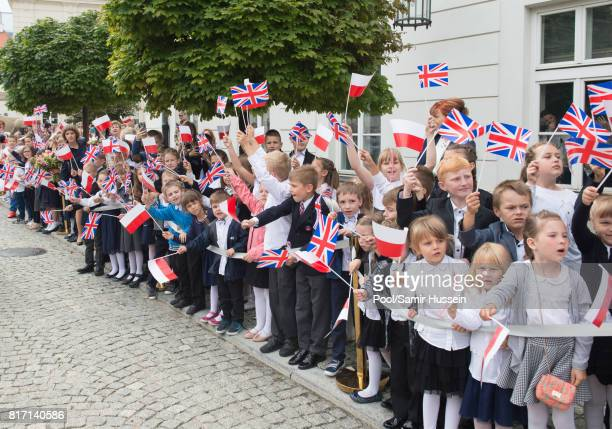 Crowds line up to see Catherine Duchess of Cambridge and Prince William Duke of Cambridge during a visit to the Presidential Palace during an...