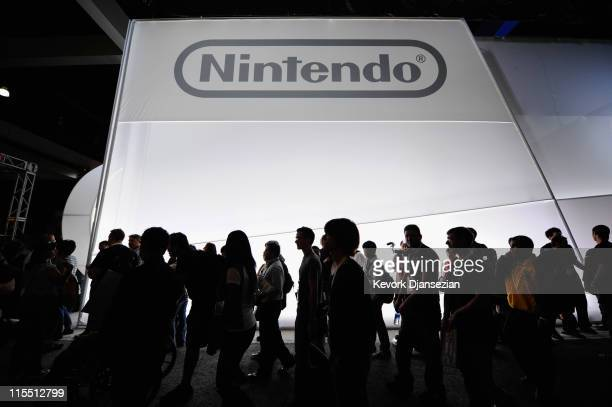 Crowds line up to view the new Nintendo game console Wii U at the Nintendo booth during the Electronic Entertainment Expo on June 7, 2011 in Los...
