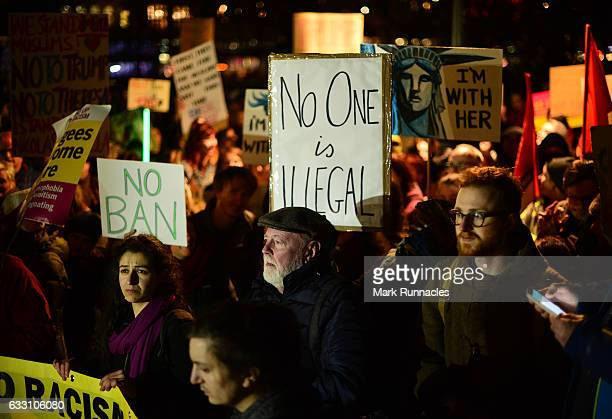 Crowds listen to a speaker at the Mound as demonstrators march to the Scottish Parliament to protest against President Trump's Muslim travel ban to...