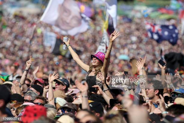 Crowds listen to Kylie perform on the Pyramid Stage at the 2019 Glastonbury Festival held at Worthy Farm, in Pilton, Somerset on June 30, 2019 near...