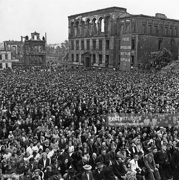 Crowds listening to a speech at Essen in Germany, 1946.