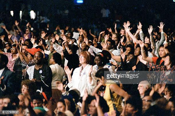 Crowds listening to Maurice Cerullo an American pentecostal televangelist during his 'Mission to London' at Earls Court London 21st June 1992