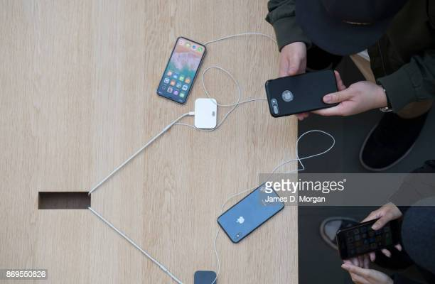 Crowds look at the new iPhone X at Apple Store on November 3 2017 in Sydney Australia Apple's latest iPhone features face recognition technology a...