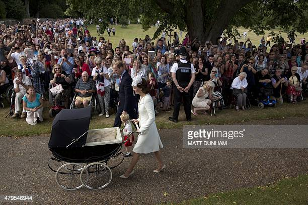Crowds look on as Britain's Catherine, Duchess of Cambridge, Britain's Prince William, Duke of Cambridge and their son Prince George of Cambridge...