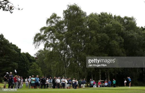 Crowds look on as Hannah Darling of Broomieknowe tees off during the Final of the R&A Girls Amateur Championship at Fulford Golf Club on August 14,...