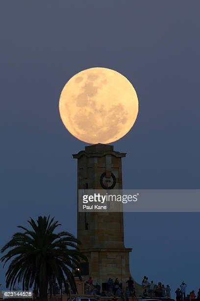 Crowds look on as the super moon rises behind the Fremantle War Memorial at Monument Hill on November 14 2016 in Fremantle Australia A super moon...