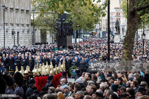 Crowds look on during the annual Remembrance Sunday memorial held around the Cenotaph on Whitehall on November 12 2017 in London England The Prince...
