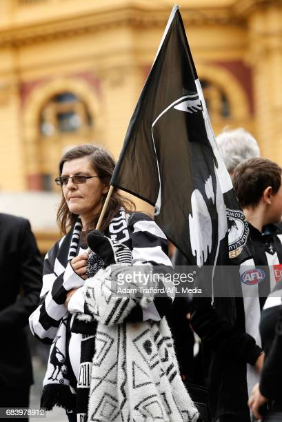 Crowds look on during the former Collingwood legend Lou Richards state funeral at St Paul's Cathedral on May 17 2017 in Melbourne Australia