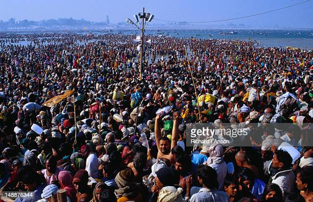 Crowds making their way to the bathing area at the sangam (confluence) of the Ganges and Yamuna Rivers at Maha Khumb Mela.