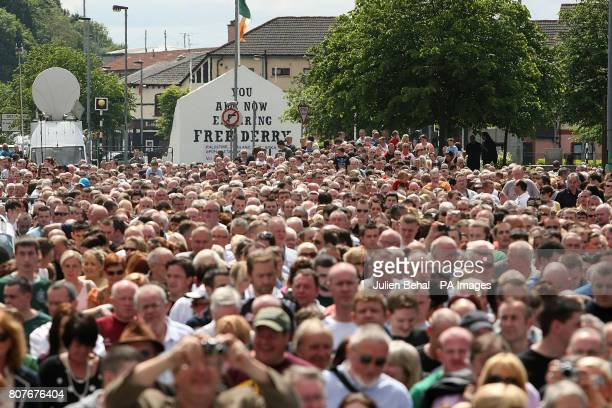 Crowds marching through Londonderry from Free Derry Corner to the Guildhall where relatives of those killed on Bloody Sunday saw the first copies of...