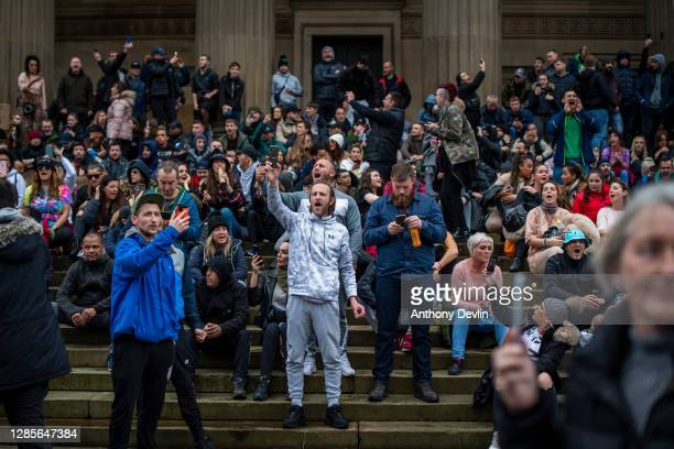Crowds not wearing face masks gather at St George's Hall during an anti lockdown protest on November 14, 2020 in Liverpool, England. Throughout the...