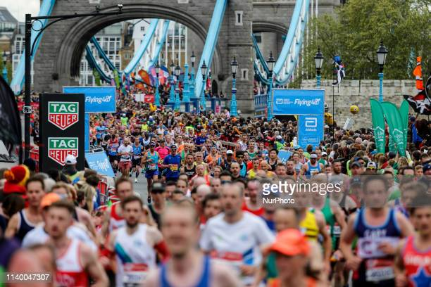 Crowds of athletes cross Tower Bridge during the Virgin Money London Marathon in London, England on April 28, 2019. Nearly 43 thousand runners...