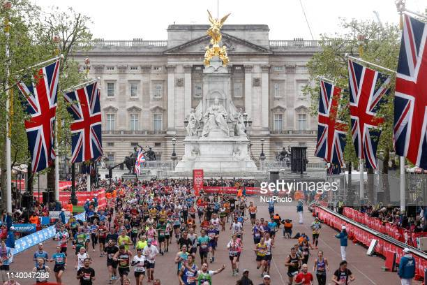 Crowds of athletes take the finishing straight in front of the Buckingham Palace during the Virgin Money London Marathon in London, England on April...