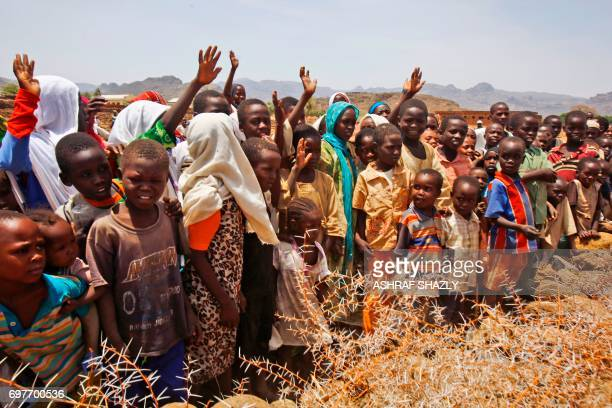 Crowds of children and villagers gather to welcome Steven Koutsis the United States' top envoy in Sudan in the wartorn town of Golo in the thickly...