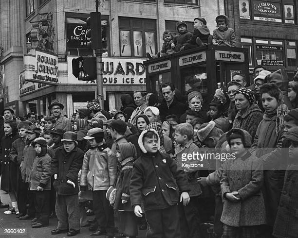 Crowds of children gathered in a New York street to watch Macy's traditional Thanksgiving parade
