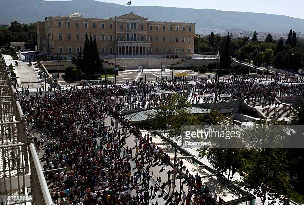 Crowds of demonstrators march past the Greek parliament building on Syntagma square during the general strike in Athens, on Wednesday, Sept. 26,...