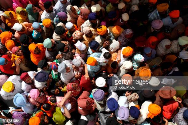 Crowds of devotees in queues during festival of Hola Mohalla at Anandpur Sahib Gurudwara in Rupnagar district, Punjab, India