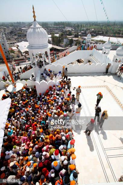 Crowds of devotees in queues during festival of Hola Mohalla at Anandpur Sahib Gurudwara in Rupnagar district, Punjab, India