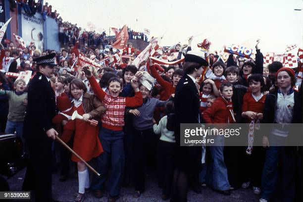 Crowds of excited supporters wait for the Liverpool team bus and manager Bill Shankly to parade the FA Cup trophy after winning the 1974 FA Cup Final...
