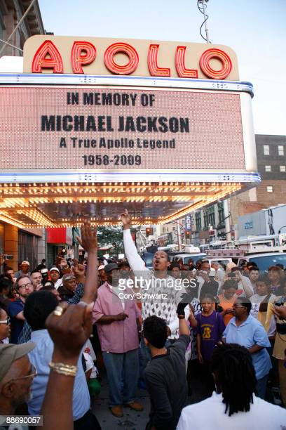 Crowds of fans gather outside of the Apollo Theater to remember pop star Michael Jackson on June 25 2009 in New York City Jackson the iconic pop star...