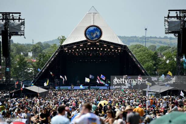Crowds of festival-goers watch Tom Odell perform on the Pyramid Stage during day three of Glastonbury Festival at Worthy Farm, Pilton on June 28,...