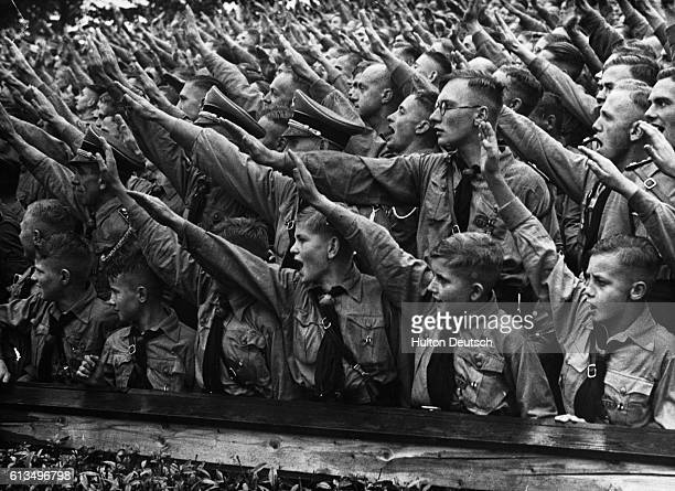 Crowds of Hitler Youth salute as they listen to a speech given by Adolf Hitler the Nazi leader at a rally at the Nuremberg Stadium in Germany 1937
