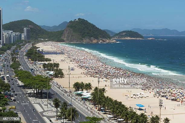 Crowds of holiday makers on Copacabana beach, Rio De Janeiro, Brazil