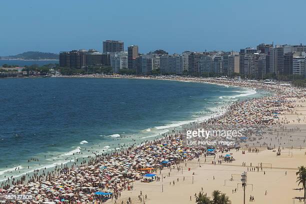 Crowds of holiday makers on Ipanema beach, Rio De Janeiro, Brazil