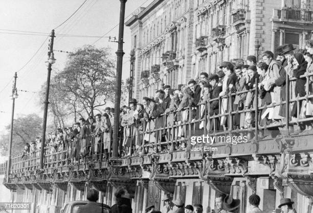Crowds of Hungarians watch the families of of Russian diplomats and army officers leave Budapest on the Danube riverboat during the Hungarian...