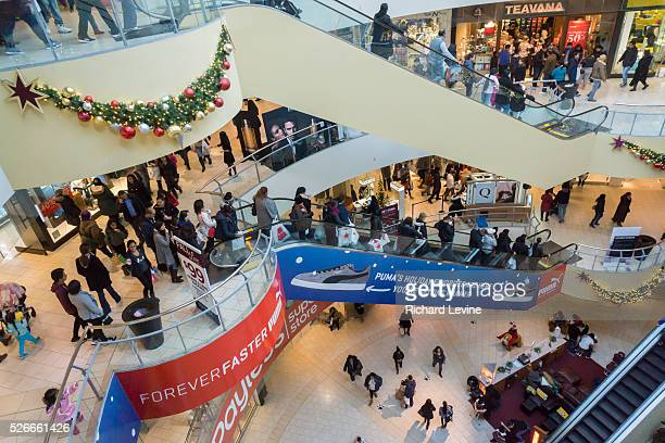 966260cea1 Crowds of last minute shoppers pack the Queens Center Mall in the borough  of Queens in