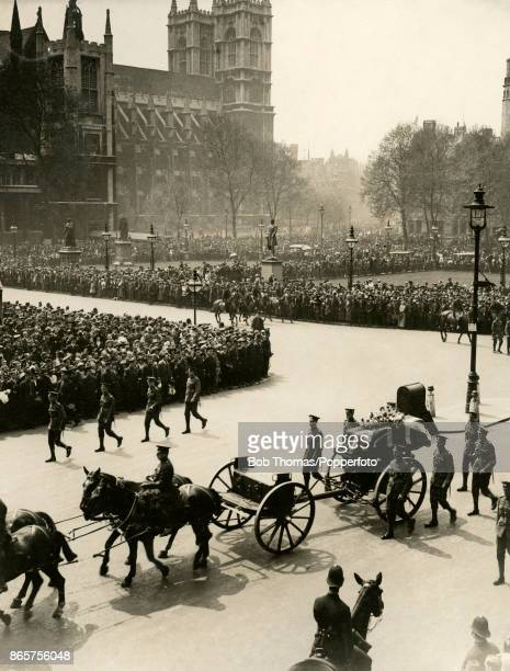 Crowds of Londoners pay their silent respect during the funeral cortege of nurse Edith Cavell executed by the Germans for treason on its way from...