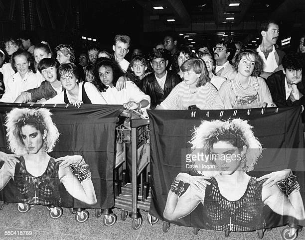 Crowds of Madonna fans holding posters as they wait at the airport for her arrival London August 13th 1987