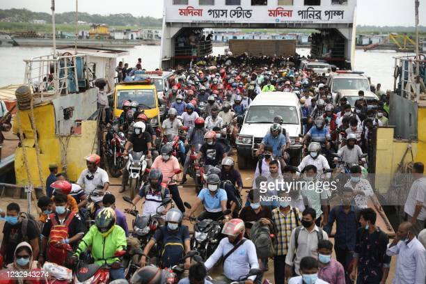 Crowds of migrant people are gathering on the ferry as they are returning back from home after the Muslim festival Eid-ul-Fitr at Shimulia ferry...