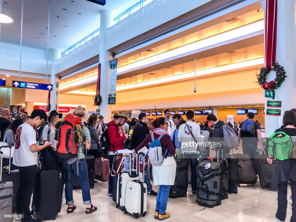 Crowds of passengers in departure area of Cancun International Airport, Mexico : Stock Photo