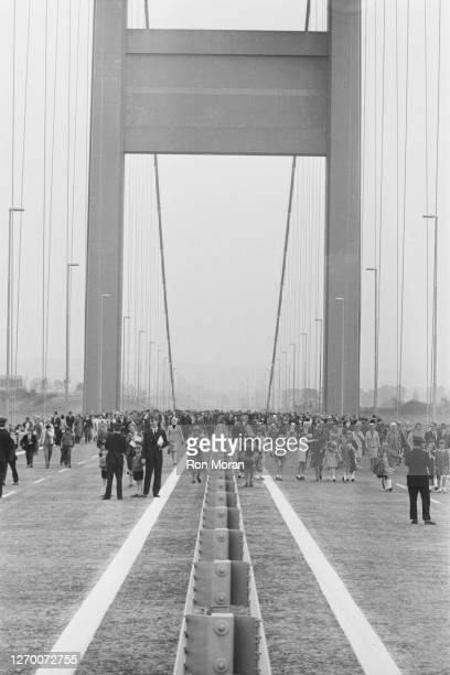 Crowds of pedestrians crossing the Severn Bridge between South Gloucestershire in England and Monmouthshire in South Wales, after it was opened by...