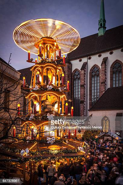 Crowds of people at Christmas market illuminated at night Basel, Switzerland