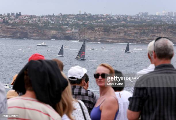 Crowds of people at North Head watch Yachts sail out of Sydney Harbour during the 2017 Sydney to Hobart on December 26 2017 in Sydney Australia