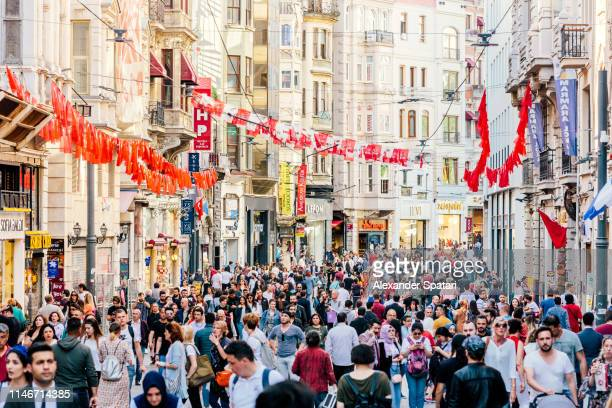 crowds of people at pedestrian shopping street istiklal caddesi in istanbul, turkey - pedestrian zone stock pictures, royalty-free photos & images