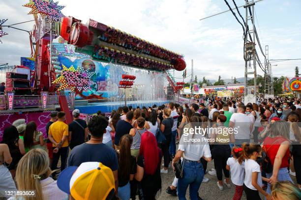 Crowds of people attend the fairgrounds of Granada with the swings and attractions installed in the area amid the coronavirus pandemic during the...