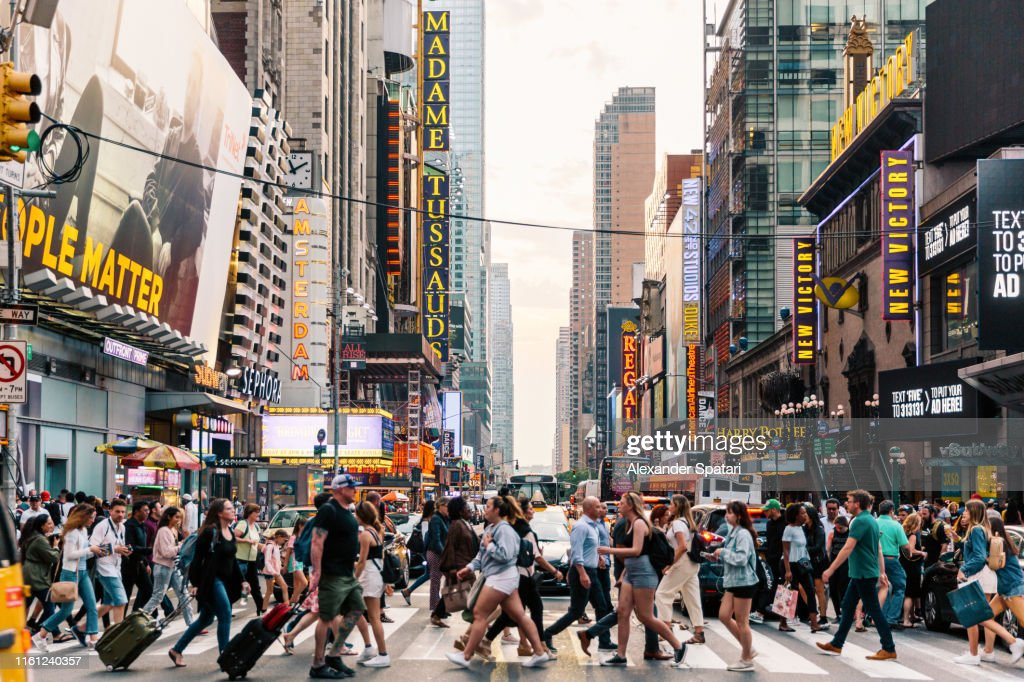 Crowds of people crossing street on zebra crossing in New York, USA : Stock Photo