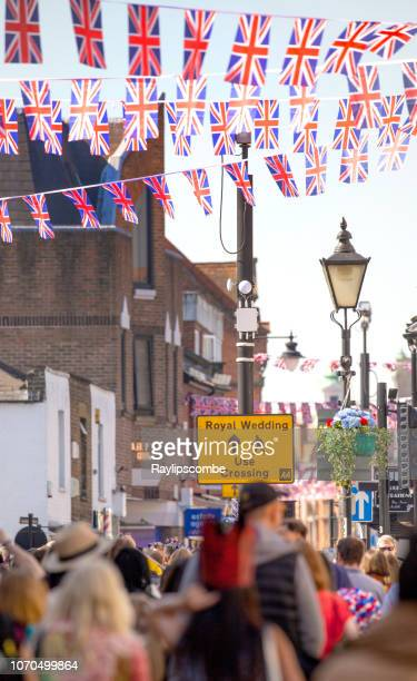 crowds of people filling the streets of windsor on their way to celebrate the marriage of meghan markle and prince harry at st george's chapel at windsor castle - meghan stock photos and pictures