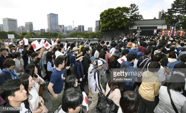 Crowds of people flock to the Imperial Palace in Tokyo on May 4 for Japanese Emperor Naruhito's first public appearance since his enthronement on May...