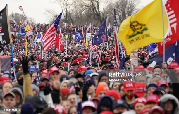Crowds of people gather as US President Donald Trump speaks to supporters from The Ellipse near the White House on January 6 in Washington, DC. -...