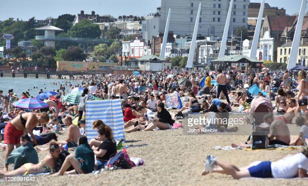 Crowds of people gather on the beach on a warm and sunny May Day bank holiday on May 25, 2020 in Southend-on-Sea, United Kingdom. The British...