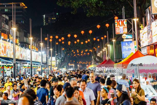 crowds of people in chinatown in kuala lumpur, malaysia - malaysia stock pictures, royalty-free photos & images