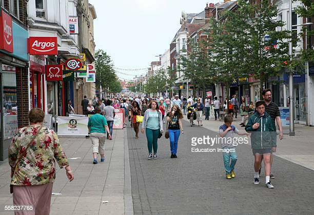 Crowds of people in main shopping street of Lowestoft Suffolk England