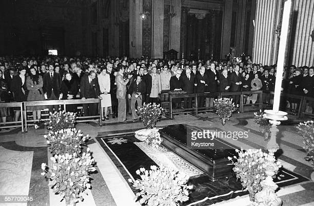 Crowds of people, including family and President Giovanni Leone, viewing the coffin of director Luchino Visconti, lying in state at the Church of St...
