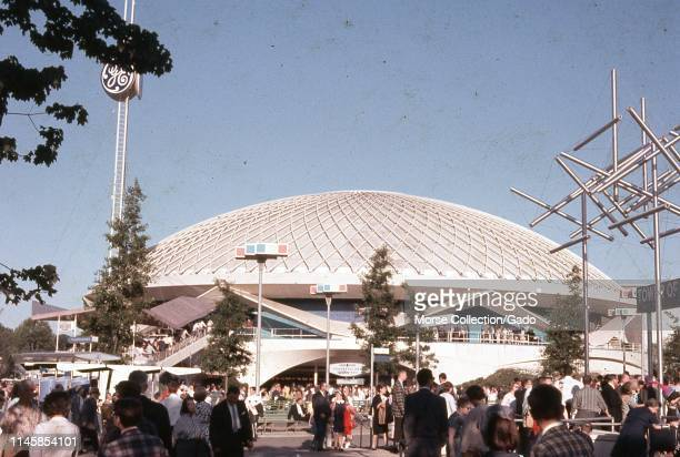Crowds of people, on a sunny day, outside the General Electric pavilion, 1964 New York World's Fair, Flushing Meadows Park, Queens, New York, June,...